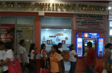 Customers line up at BPI - ATM machine at South Seas Mall, Cotabato City, Philippines